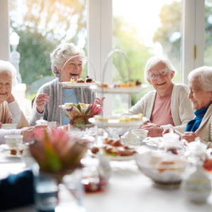 senior women at tea party
