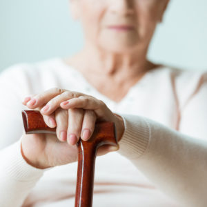 elderly woman holding cane