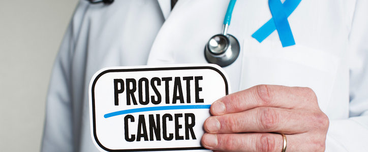 doctor holding prostate cancer sign
